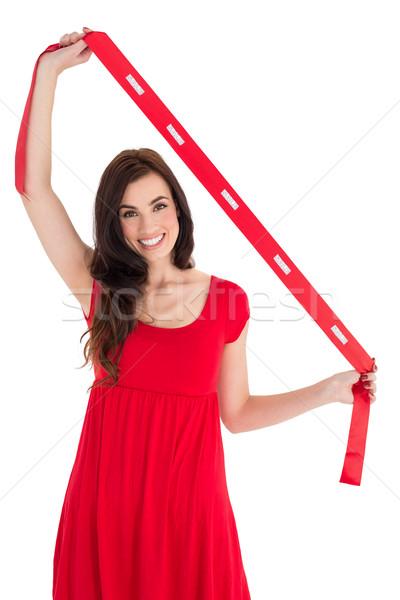 Stylish brunette in red dress holding scarf Stock photo © wavebreak_media