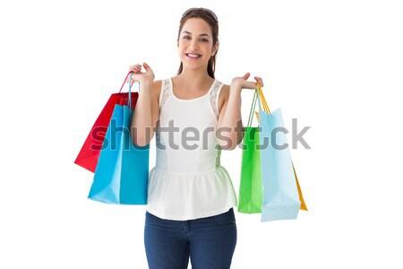 Cheerful brown hair holding shopping bags Stock photo © wavebreak_media