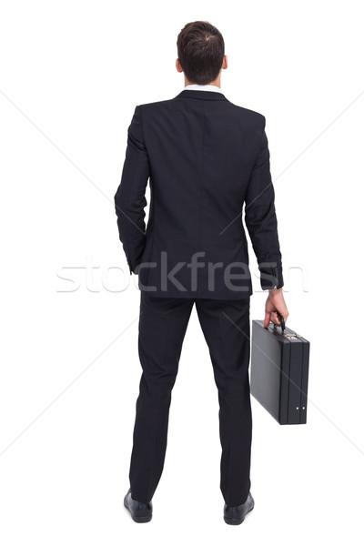 Hátsó nézet üzletember tart aktatáska fehér öltöny Stock fotó © wavebreak_media