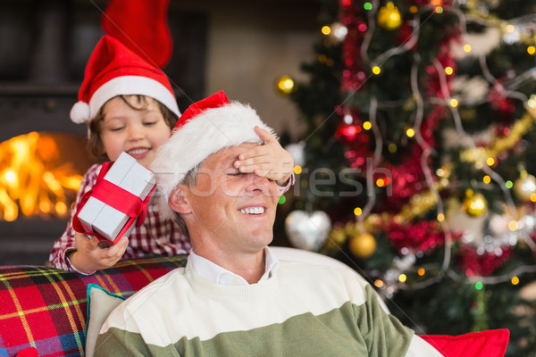 Son surprising his father with christmas gift Stock photo © wavebreak_media