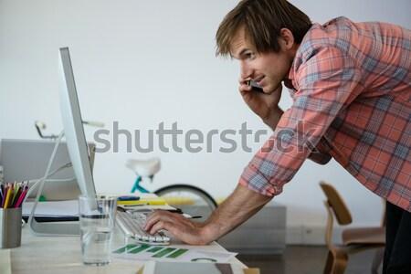 Plumber putting filling in between tiles Stock photo © wavebreak_media