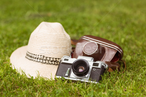 Vintage camera with his cover near a straw hat Stock photo © wavebreak_media