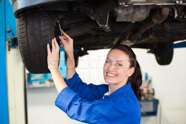 улыбаясь механиком шин ремонта гаража службе Сток-фото © wavebreak_media