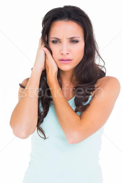 Pretty brunette getting an earache Stock photo © wavebreak_media