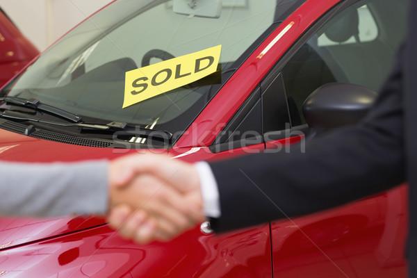 Person shaking hands in front of a sold car Stock fotó © wavebreak_media