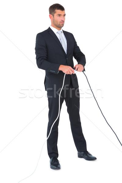 серьезный бизнесмен Plug белый человека Сток-фото © wavebreak_media