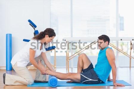 Trener kobieta siedzieć człowiek szczęśliwy fitness Zdjęcia stock © wavebreak_media