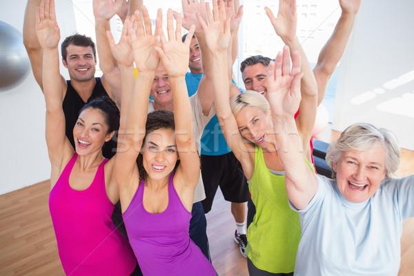 Derűs barátok kezek kiemelt fitnessz stúdió Stock fotó © wavebreak_media