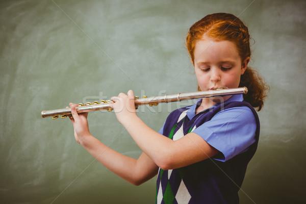 Cute meisje spelen fluit klas portret Stockfoto © wavebreak_media