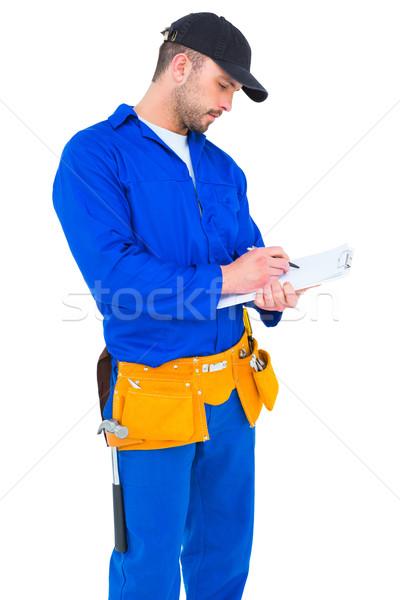 Tuttofare blu complessivo iscritto appunti bianco Foto d'archivio © wavebreak_media