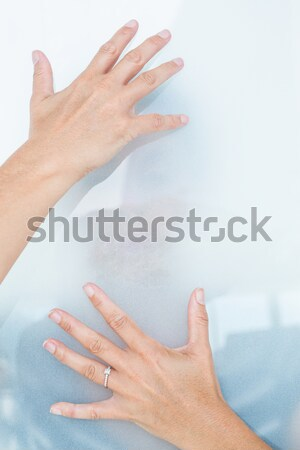 Sad blonde woman behind frosted glass Stock photo © wavebreak_media