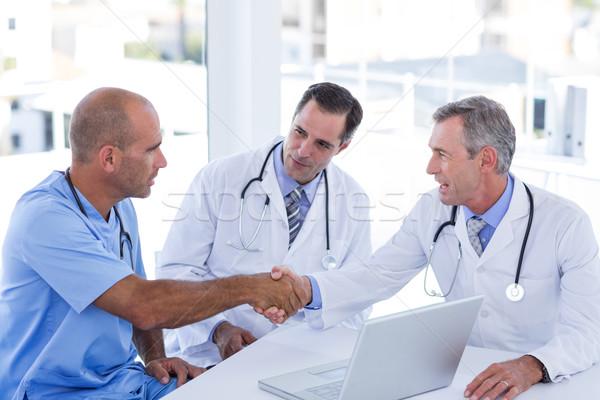 Doctors doing hands shakes  Stock photo © wavebreak_media