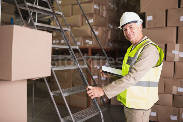 Worker with diary in warehouse Stock photo © wavebreak_media