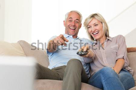 Happy couple with pet cat on sofa Stock photo © wavebreak_media