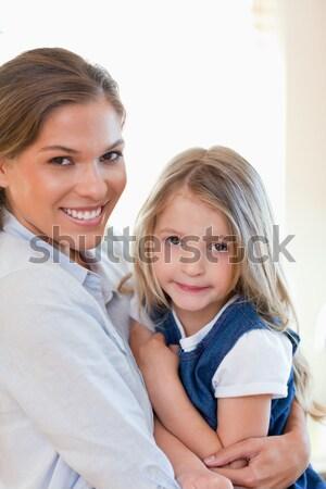 Happy siblings smiling at camera together Stock photo © wavebreak_media