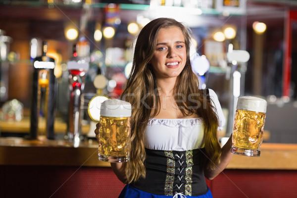 Mosolyog Oktoberfest sör bár női kocsma Stock fotó © wavebreak_media