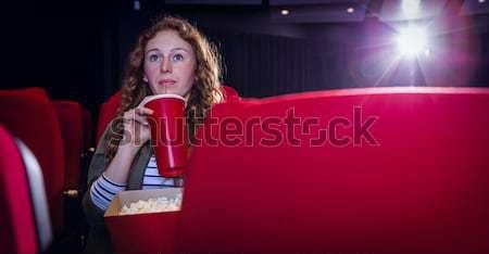 Fiatal nő néz film iszik üdítő mozi Stock fotó © wavebreak_media