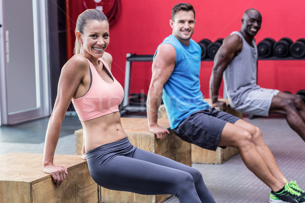 Stock photo: Muscular athletes doing reverse push up