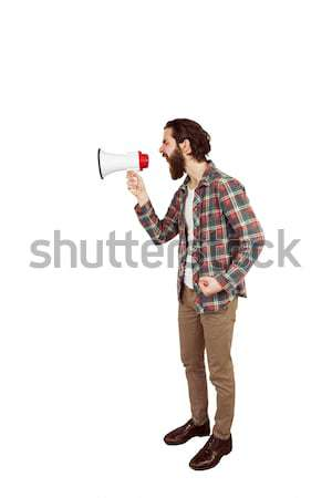 Handsome hipster shouting through megaphone Stock photo © wavebreak_media