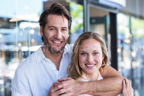 Souriant homme bras autour petite amie portrait Photo stock © wavebreak_media