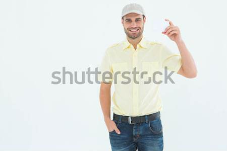 Happy Man holding his hat against blue background Stock photo © wavebreak_media