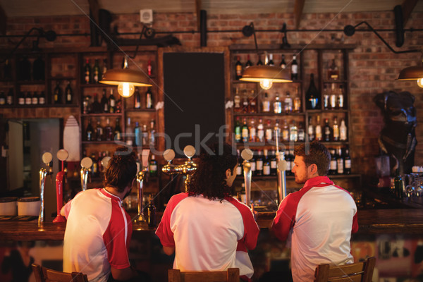 Group of male friends sitting at counter Stock photo © wavebreak_media