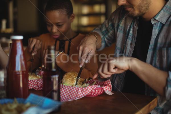 Barátok hamburger együtt étterem sör hotel Stock fotó © wavebreak_media