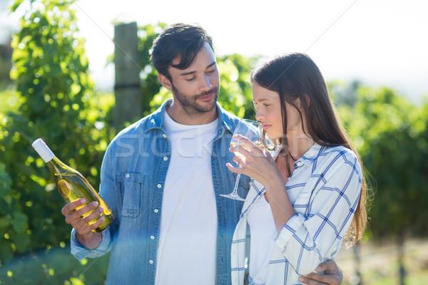 Man looking at girlfriend drinking wine Stock photo © wavebreak_media