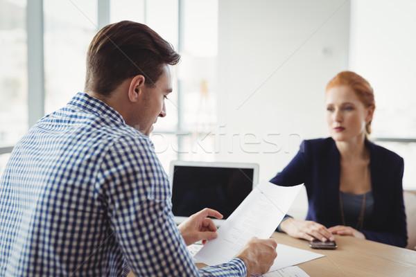 Executive reading document at desk Stock photo © wavebreak_media