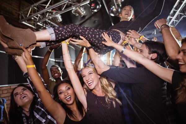 Cheerful fans lifting performer at nightclub Stock photo © wavebreak_media