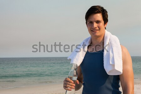 Man gebed positie strand vergadering Stockfoto © wavebreak_media