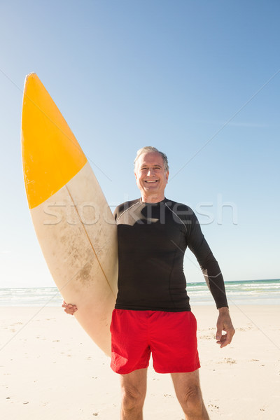 Vista sonriendo hombre tabla de surf Foto stock © wavebreak_media