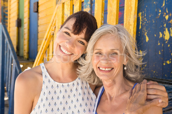 Portrait of smiling mother and daughter standing against wall Stock photo © wavebreak_media
