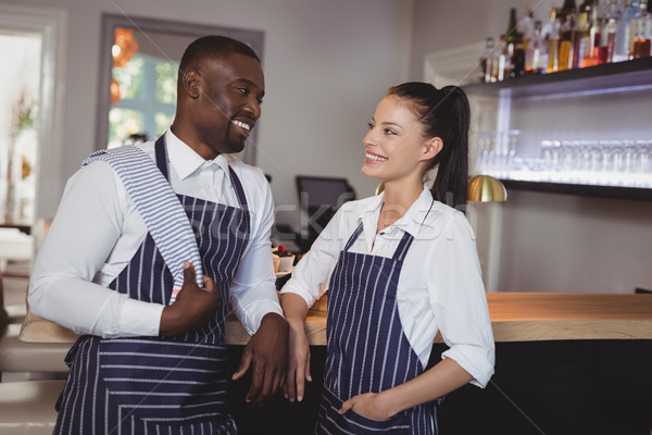 Smiling waiter and waitress standing at counter Stock photo © wavebreak_media