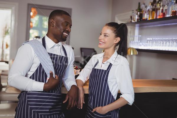 улыбаясь официант официантка Постоянный борьбе ресторан Сток-фото © wavebreak_media