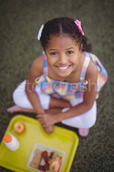 Portrait of happy schoolgirl having meal Stock photo © wavebreak_media