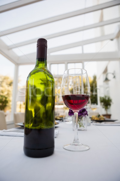 Red wine and bottle on table in restaurant Stock photo © wavebreak_media