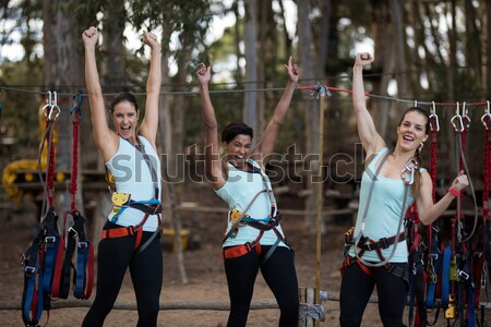 Group of women carrying a heavy wooden log during obstacle course Stock photo © wavebreak_media