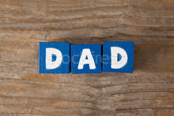 Blue cube shapes with dad text on table Stock photo © wavebreak_media