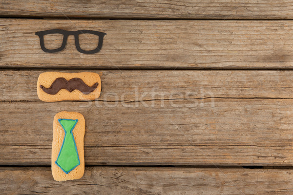 Cookies with mustache and necktie shape decorataion on table Stock photo © wavebreak_media