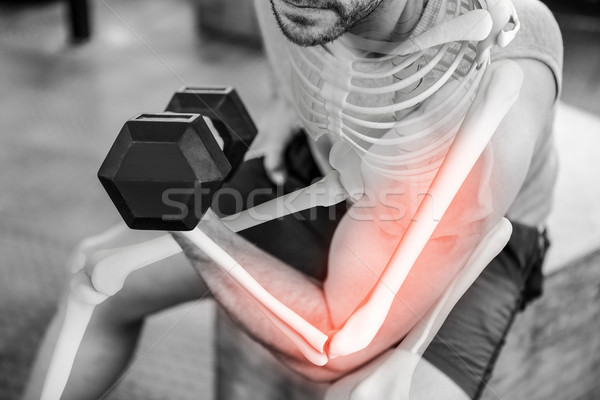 Highlighted arm of strong man injecting anabolic steroid at gym Stock photo © wavebreak_media