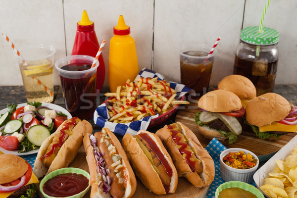 Drinks and snacks on wooden table Stock photo © wavebreak_media