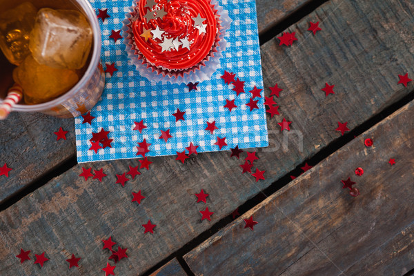 Stock photo: Decorated cupcake and cold drink with 4th july theme