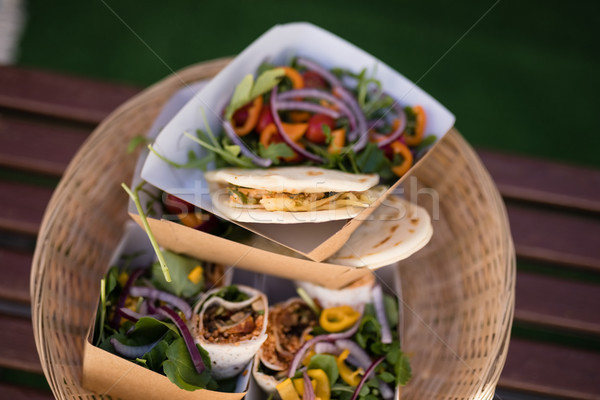 Meal and snacks in wicker basket at counter Stock photo © wavebreak_media