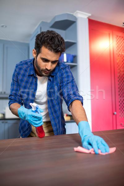 Man cleaning wooden table Stock photo © wavebreak_media