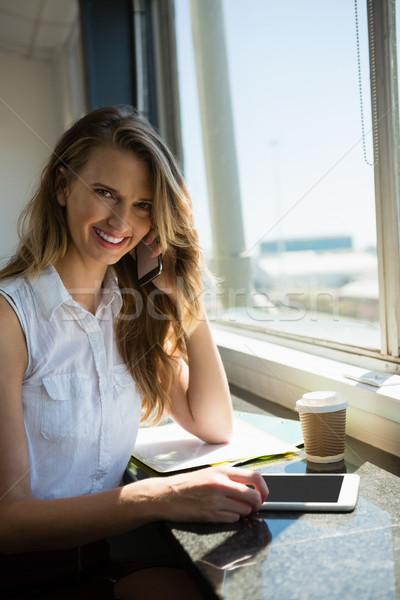 Portrait of smiling businesswoman talking on mobile phone Stock photo © wavebreak_media
