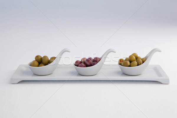 Various olives in container on white background Stock photo © wavebreak_media