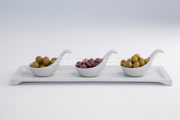 Olives contenant blanche plateau vin Photo stock © wavebreak_media