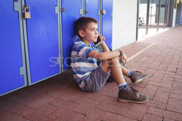 Magasról fotózva kilátás fiú beszél mobiltelefon ül Stock fotó © wavebreak_media