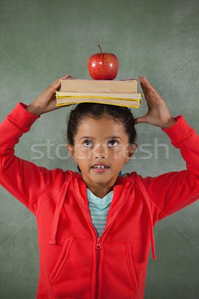книгах яблоко голову мелом Сток-фото © wavebreak_media